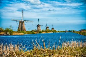Бесплатные фото Kinderdijk, Нидерланды, Голландия, канал, мельницы, пейзаж