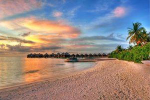 Фото бесплатно закат, бунгало, пляж