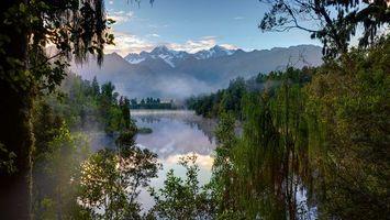 Заставки Озеро Мэтисон,Новая Зеландия,закат,горы,деревья,пейзаж