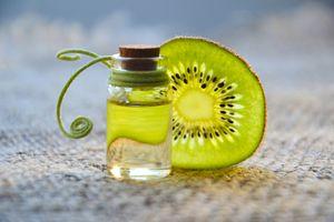 Photo free cosmetic oil, kiwi, essential oil
