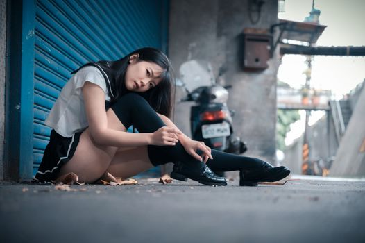 Photo free young woman, schoolgirl, legs