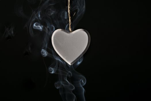 Locket heart in smoke · free photo