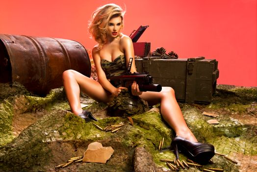 Sexy blonde with a rifle