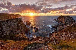 Фото бесплатно закат, море, скалы, берег, пейзаж