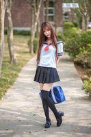 Photo free young woman, schoolgirls, posing