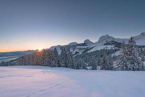 Бесплатные фото зима,закат,горы,деревья,пейзаж,Швейцария