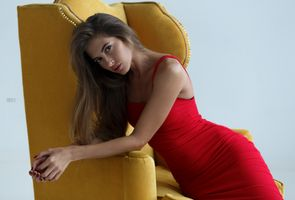 Beautiful brown-haired woman in a red dress
