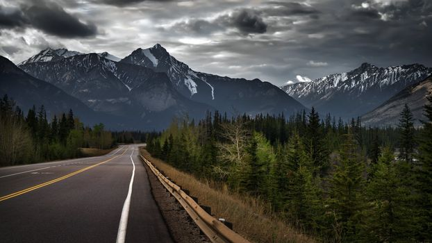 Photo free long road, mountains, dark clouds
