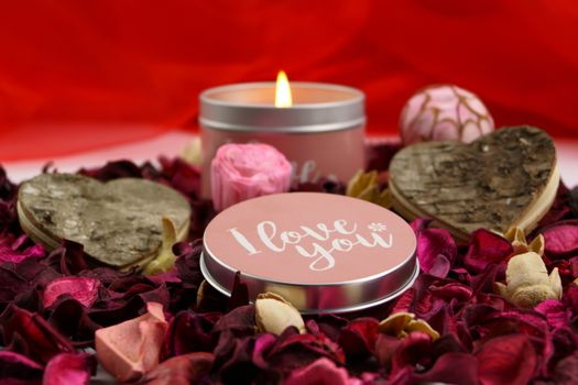 Valentine`s day roses and candle · free photo