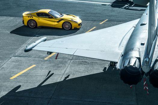 Photo free Ferrari F12 Tdf, yellow, airport
