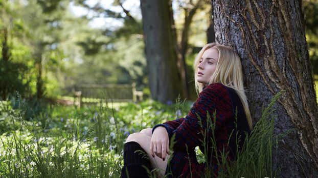 Sophie Turner Sits By the Tree