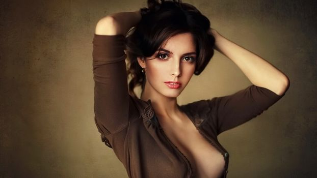 Photo free brunette, blouse, hands behind head