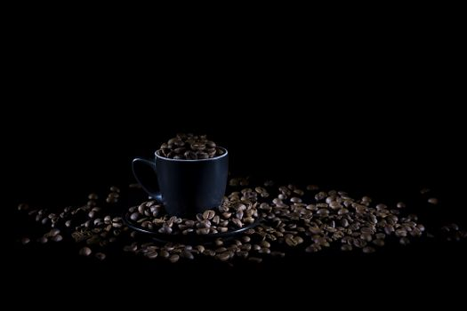 Cup with coffee beans · free photo