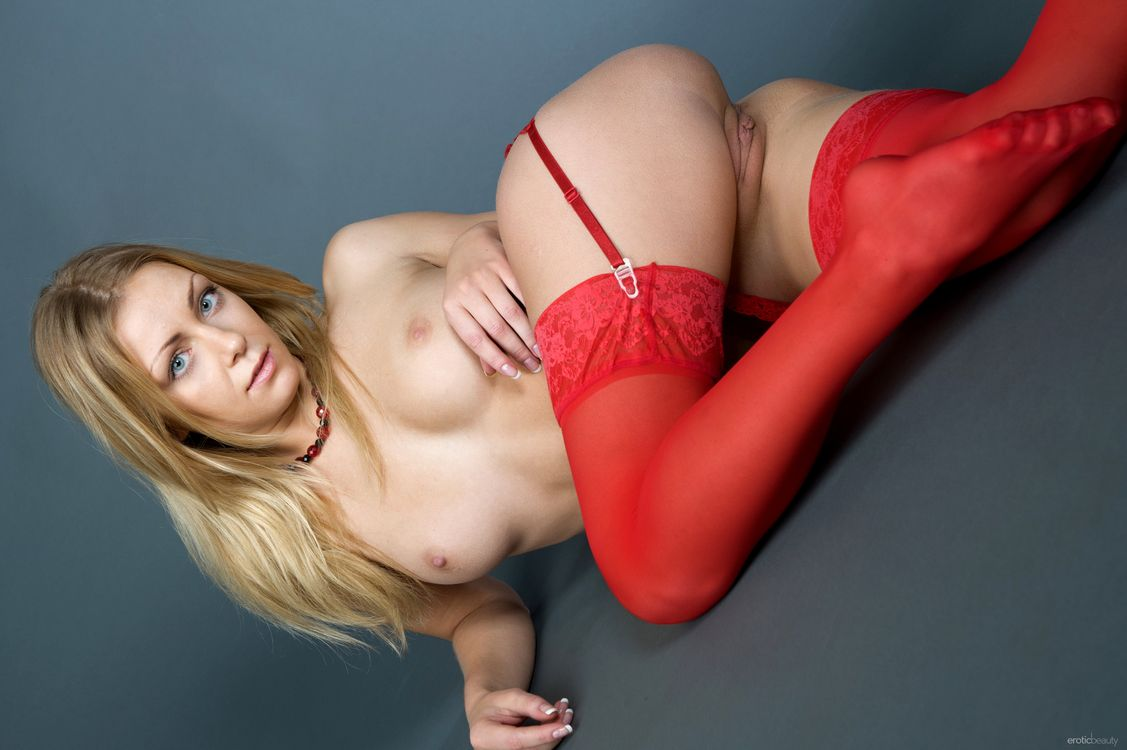 Naked blonde in red stockings · free photo