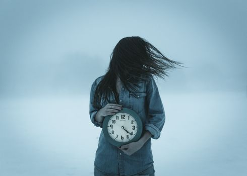 The girl with a clock · free photo