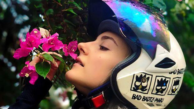 A girl in a motorcycle helmet