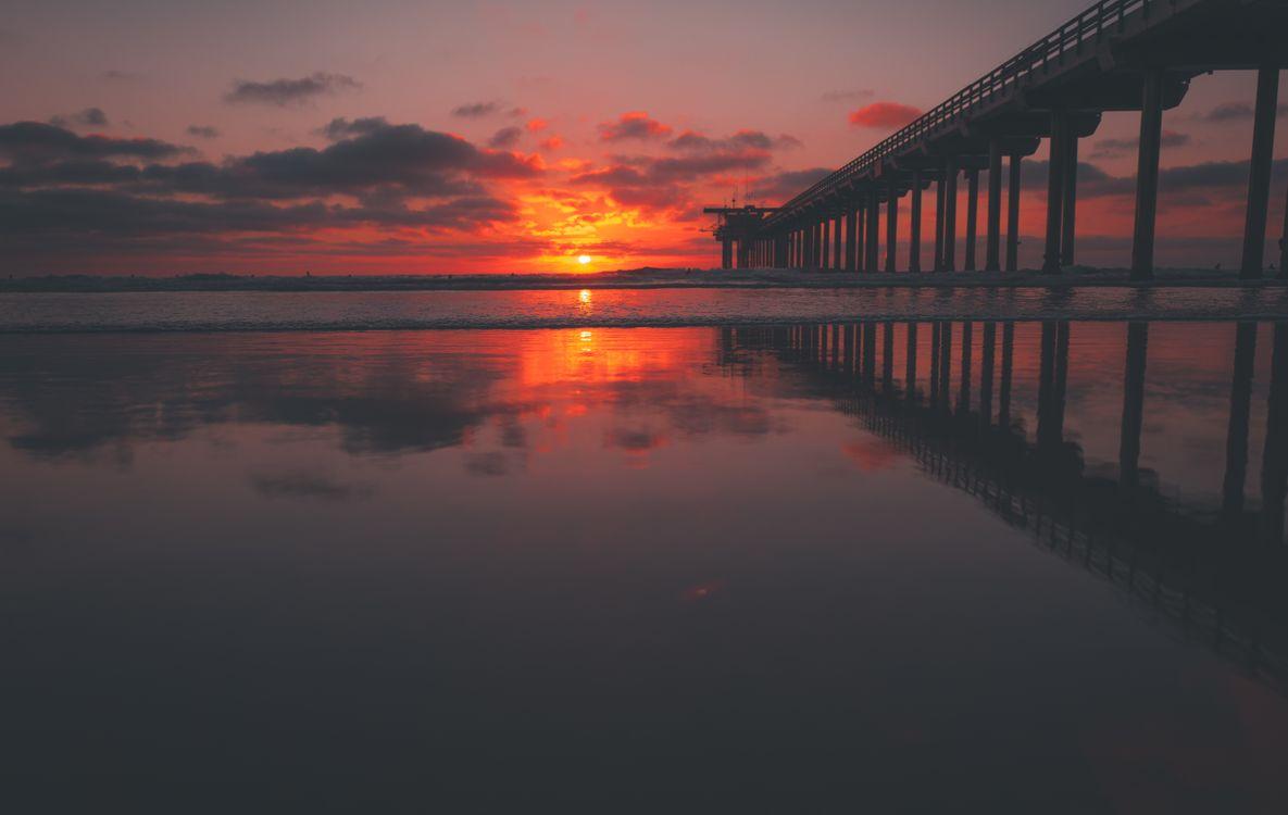 Закат и мост · бесплатное фото