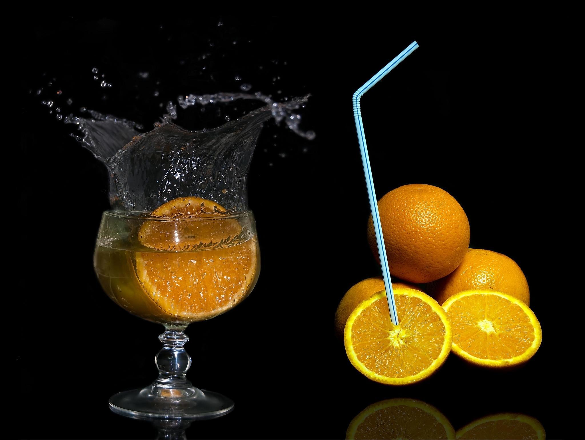 Обои апельсины, цытрусы, фрукты, чёрный фон