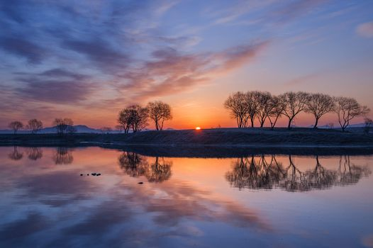 Autumn sunset by the river · free photo