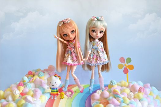 Dolls and trail of rainbow · free photo