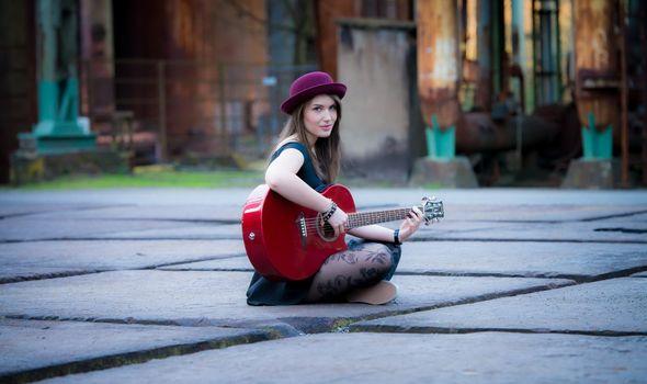 Photo free girl, guitar, sitting