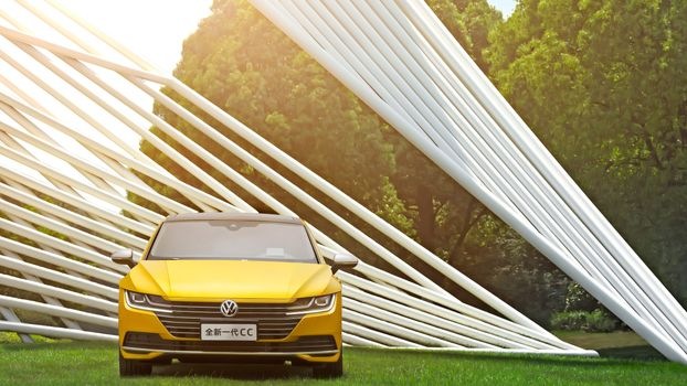Photo free Volkswagen CС yellow, on the lawn, weed