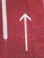 The red arrow on the pavement