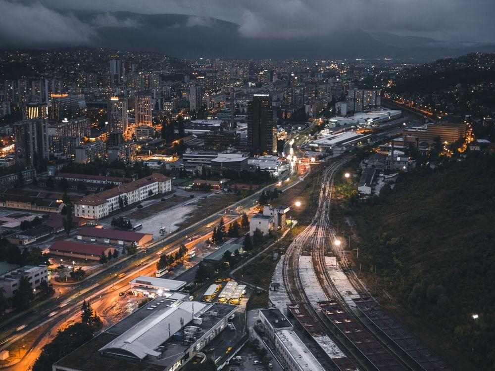 Обои night city, top view, buildings, railway картинки на телефон