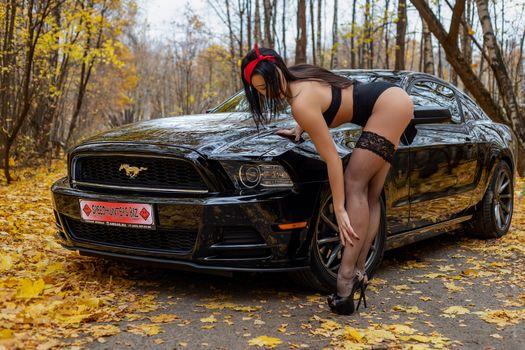 Photo free beautiful girl in stockings, car, Mustang