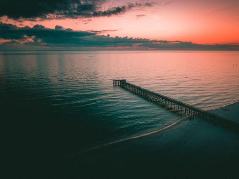 Бесплатные фото пейзаж,облака,закат,вода,озеро,море,пляж,пирс,причал,оранжевый