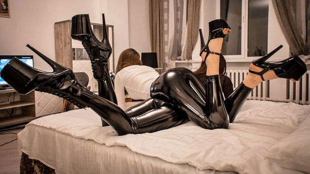 Photo free two girls, beds, latex