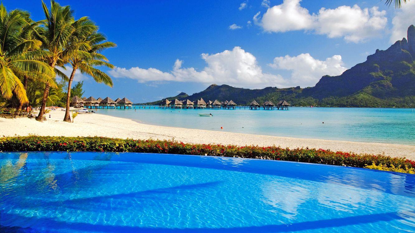 Фото бесплатно море, остров, пляж, пальмы, отдых, тропики, пейзажи