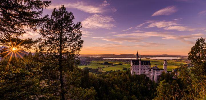 Фото бесплатно Sunset Over Schloss Neuschwanstein, Hohenschwangau, Bavaria