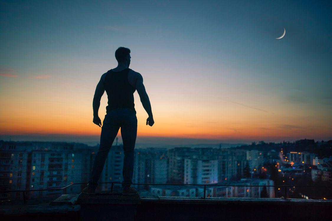 Free photo man, silhouette, night, roof - to desktop